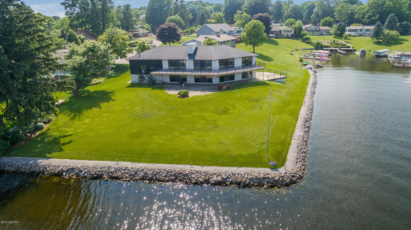county jackson lakefront max re lake sale for michigan in estate homes realestatehomesforsale midmi wolf real big cottages cottage mi